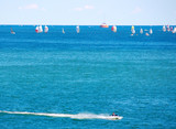 Sailboat race with speeding jetski in foreground poster