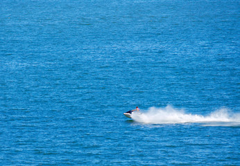 Jetski on lake making a big spray