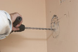 A powertool creating an opening in a wall poster