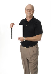 Mature man standing holding blank booklet