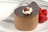Chocolate and hazelnut mousse served with  raspberries. poster