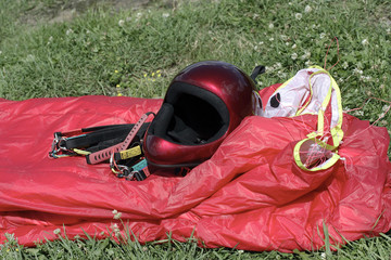 Paragliding equipment on grass
