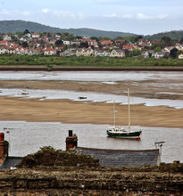 Small town and fishing - boat on low-tide