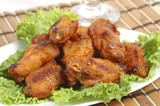 Spicy hot barbecued wings on bed of lettuce. poster