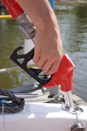 Leinwandbild Motiv Man Holding gas Bowser Pump
