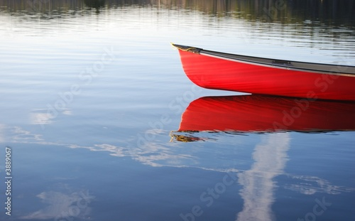 Red Canoe reflection in lake in Algonquin Park