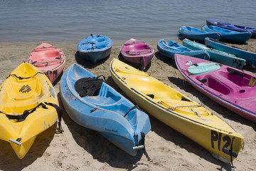 Colorful kayaks at a lake 1