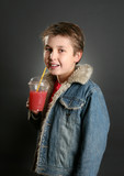 Child drinks healthy fruit juice containing apple & berries. poster