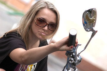 Beautiful girl go on a motorbike