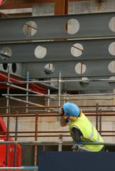 Construction worker using 2 way radio
