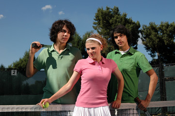 Twin brothers and a pretty girl on the tennis court