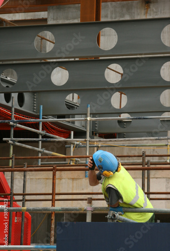 Construction worker using 2 way radio