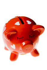 Red pig moneyboxe isolated on a white background.