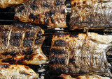 barbecue with delicious roasted  fish on grill poster
