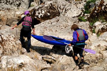 Preparation for kayaking on a river Soca, Slovenia,