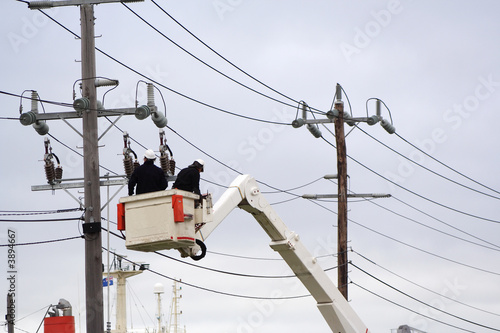 Workers in cherry picker
