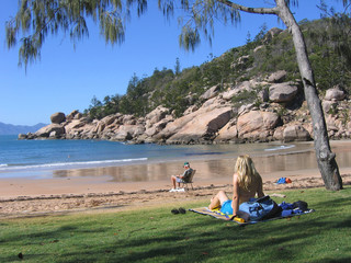 Woman sitting on the beach, Magnetic Island, Australia