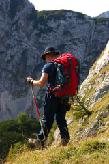 Mountaineer hiking in mountains, slovenia, europe
