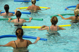 Wemen doing water aerobic in pool poster