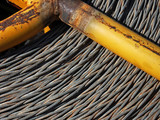 Roll of steel cable ready to wire a power line poster