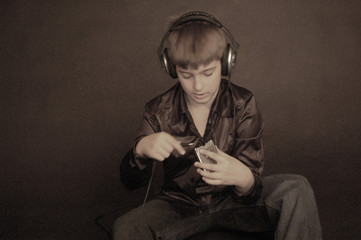 kid plugs in earphones to palm