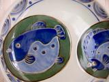 Assiette en céramique avec décor de poisson poster