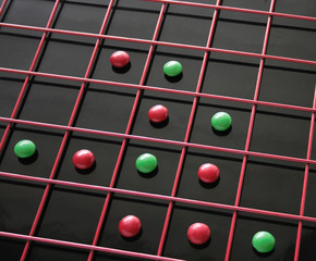 red and green discs in a red grid