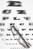Vision Care Concept - a pair of glasses and eye chart. poster