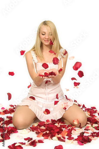 The beautiful girl with petals of roses.