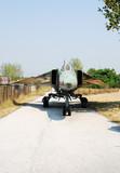 Soviet era jet fighter in remote location poster