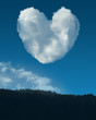 valentine's clouds acting like a heart over a blue sky