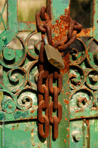 Rusty chain and padlock lock on an heavily weathered door