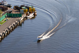 high speed motor boat with wave trail on the water poster