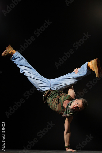freazing breakdancer standing on arm