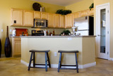 Modern kitchen with stainless steel appliances poster