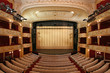 Theater stage with gold safety curtains