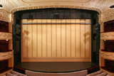 Theater stage with gold safety curtains poster