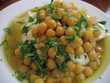 Dish of fresh Hummus in close up - Middle East food