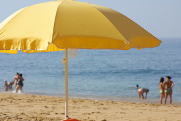 Yelow umbrella on the beach.