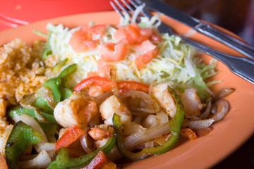 Shrimp Fajita Dinner with Rice and Salad at a Mexican Restaurant