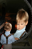 Small boy in front of spherical mirror