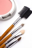 Cosmetic brushes with face powder in white background. poster