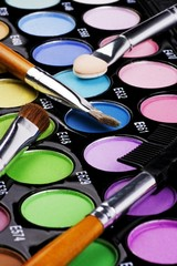 A make-up multi colored palette close up.
