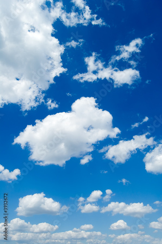 White clouds in the blue sky. Cloudscape