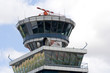 Airport control tower over cloudy blue sky