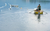 Man is rowing to the mussels farm spot to harvest mussels poster