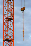 Part of the building crane with a hook and slings. poster