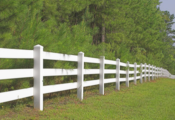 A decorative white split rail fence.