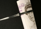 Britsh Pound notes tied with plastic cable strap. poster
