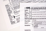 A United States income tax form, 1040. poster